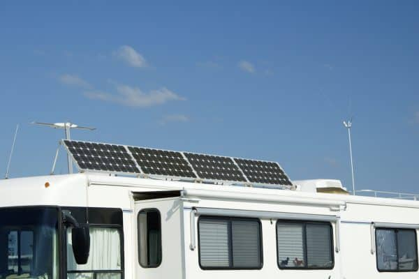 Camping with solar panels for converting energy from the sun to electricity.