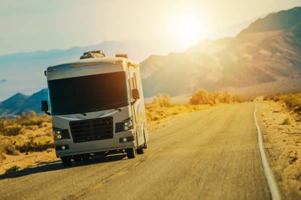 Motorhome on the Desert Road Somewhere in the Southern California Mojave Desert. Class A Gasoline Engine Motorcoach. United States of America. American RVing. (Motorhome on the Desert Road Somewhere in the Southern California Mojave Desert. Class A Ga