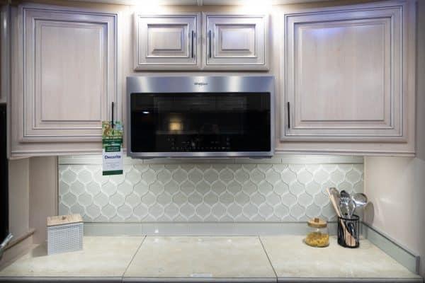 microwave in white RV kitchen.