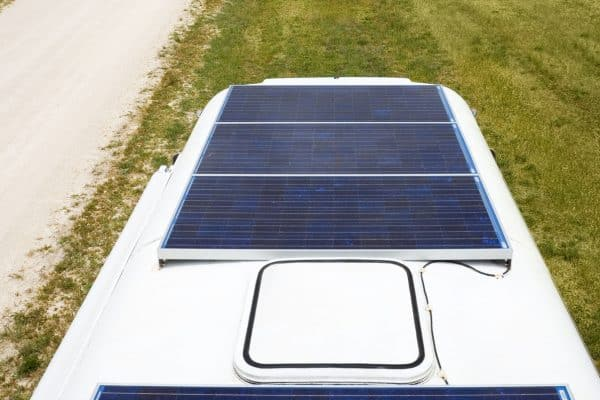 Solar panels on top of a motor home under bright overcast sky. A sky such as this will give about 25% of peak capacity. Photographed in South Australia. (Solar panels on top of a motor home under bright overcast sky. A sky such as this will give about