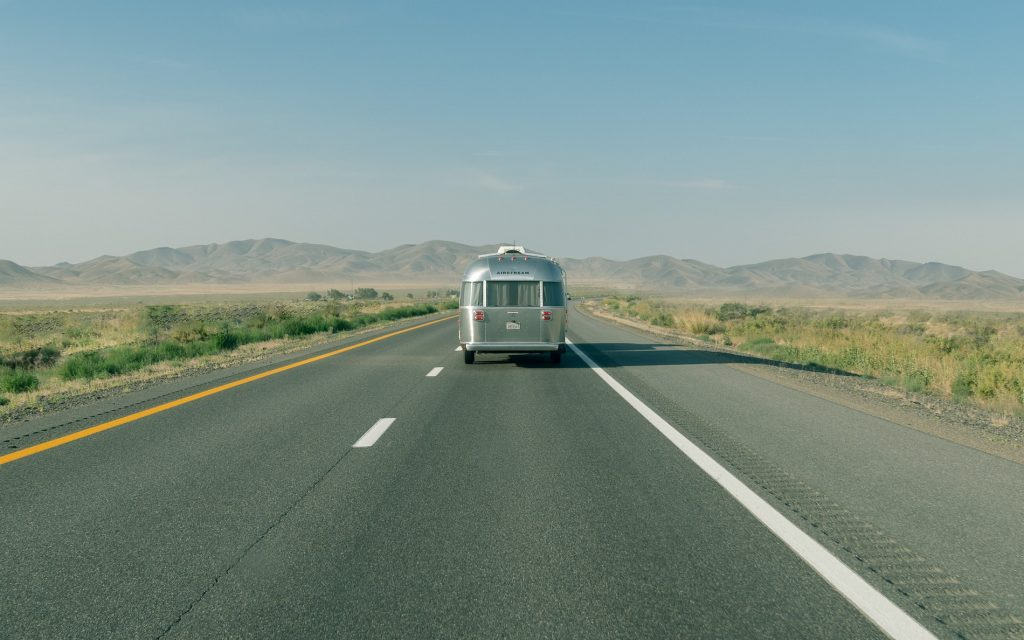 airstream travel trailer on the road