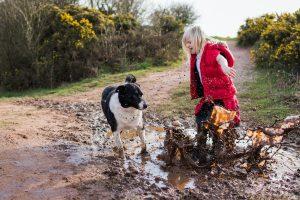 Muddy kid and pet