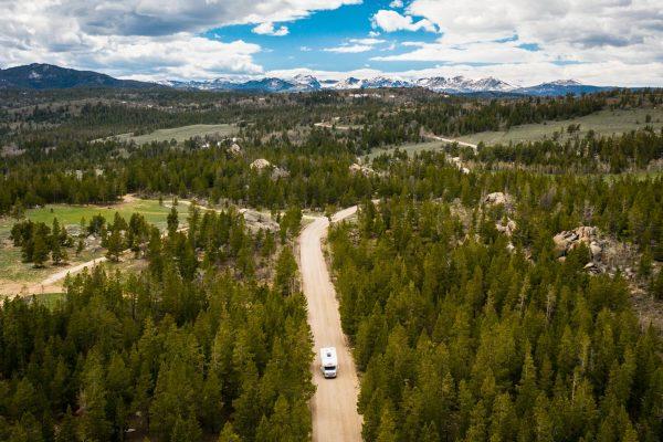 RV driving through Rocky Mountains