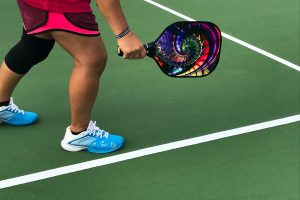 pickleball player with paddle